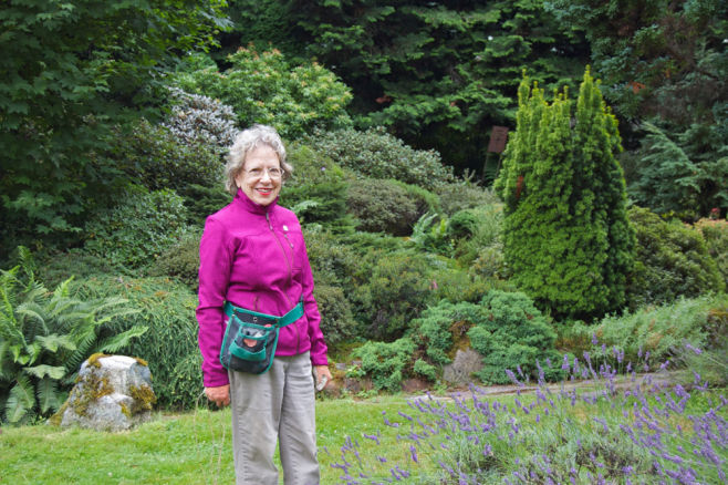 Leanette Bassetti smiling with conifer and woodland plants
