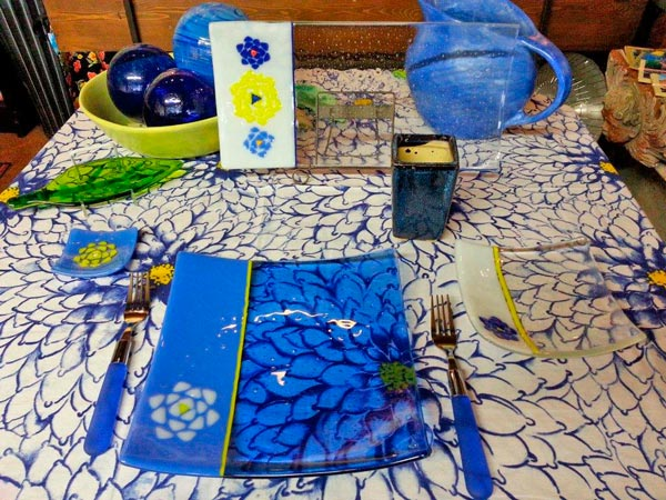 blue glass plate and tablecloth