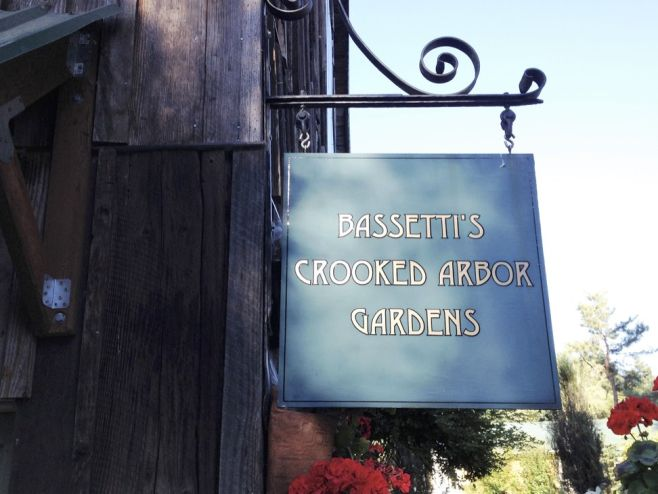 Bassettis' Crooked Arbor Gardens sign on barn