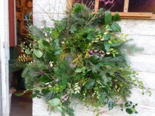 Natural wreath made from evergreen branches and twigs