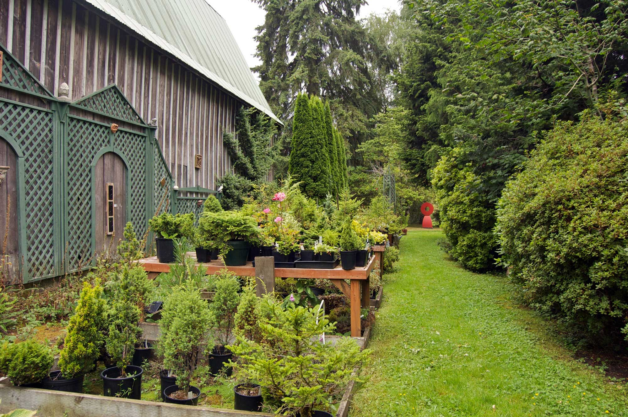 plant nursery by a barn