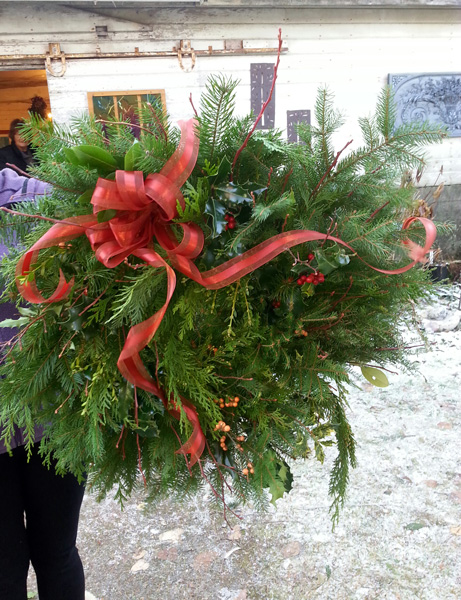 handmade wreath with big red bow