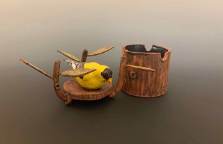 Ceramic vessel with yellow bird on the lid by Judy Thomas
