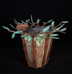 Ceramic vessel with leaves and wood motif by Judy Thomas