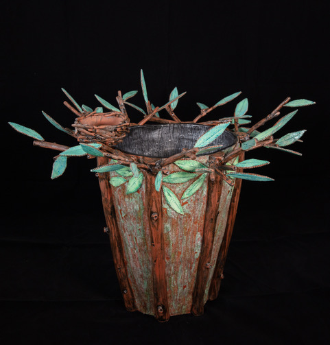Ceramic vessel with leaves and bird's nest by Judy Thomas