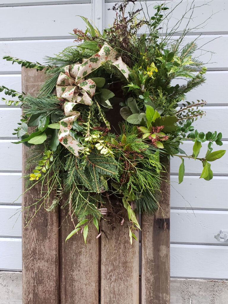 Holiday wreath made with evergreens, salal, huckleberry and more